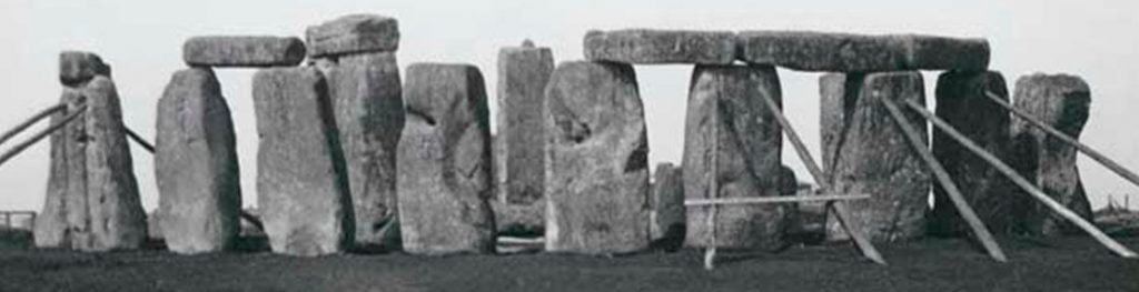 Buy Stonehenge Models: cropped Looking south west showin stones of the outer circle propped with timbers 1919 1024x263  - Whole Stonehenge? - Whole Stonehenge?