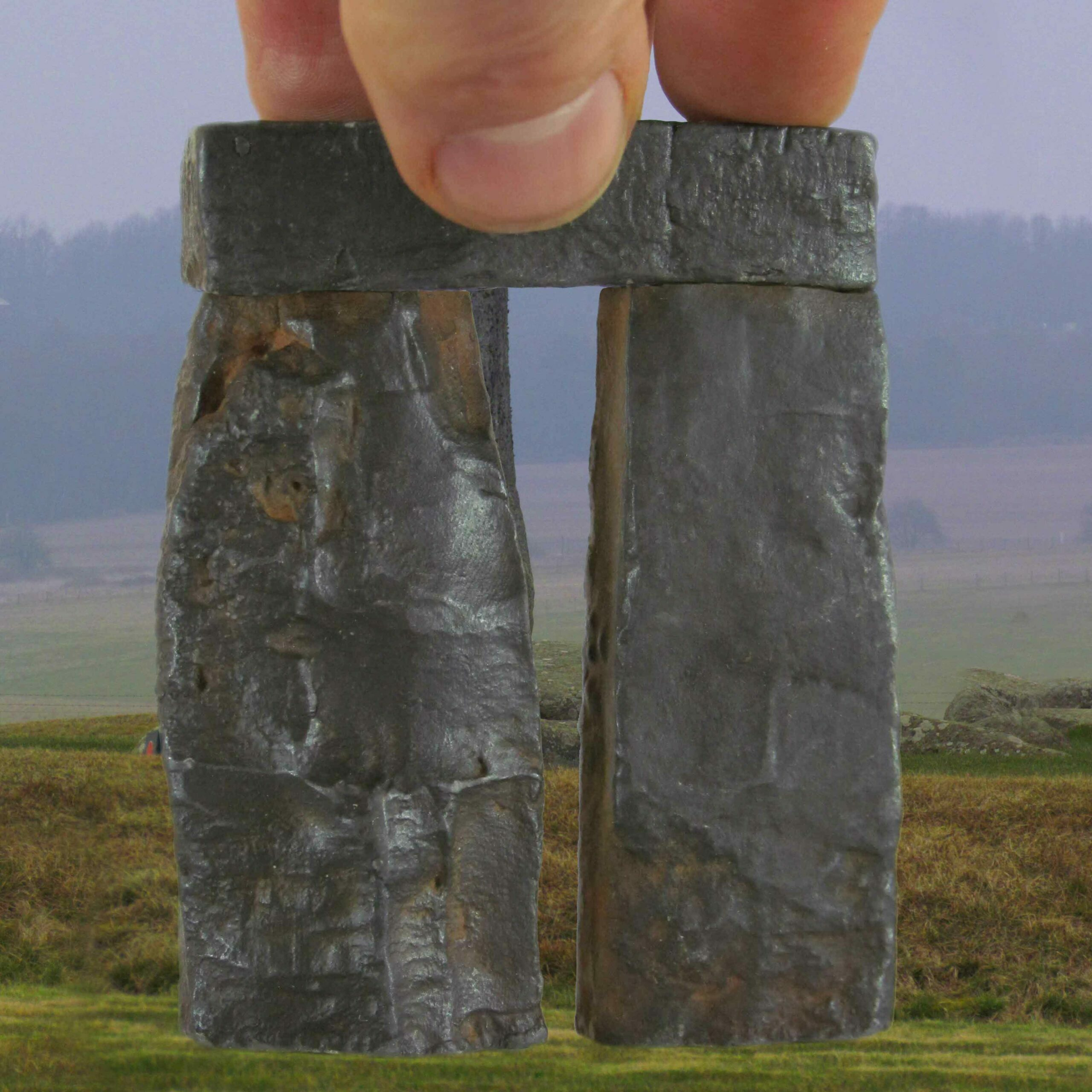 Trilithon Two, Stonehenge 76th scale rusty iron cold cast, fingers for scale on grass