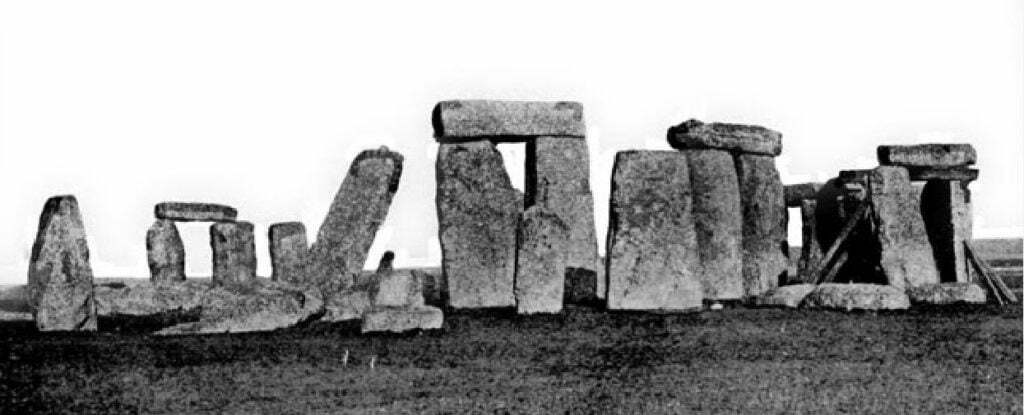 view of Stonehenge showing leaning stone 56 and timber supports